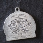 Ken Bob's finisher medal - back, Boston Marathon (2005)