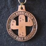 Tucson Half-Marathon finisher medal