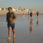 Low-Tide run at sunset in Sunset Beach CA