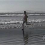 Ken Bob Saxton running barefoot on beach