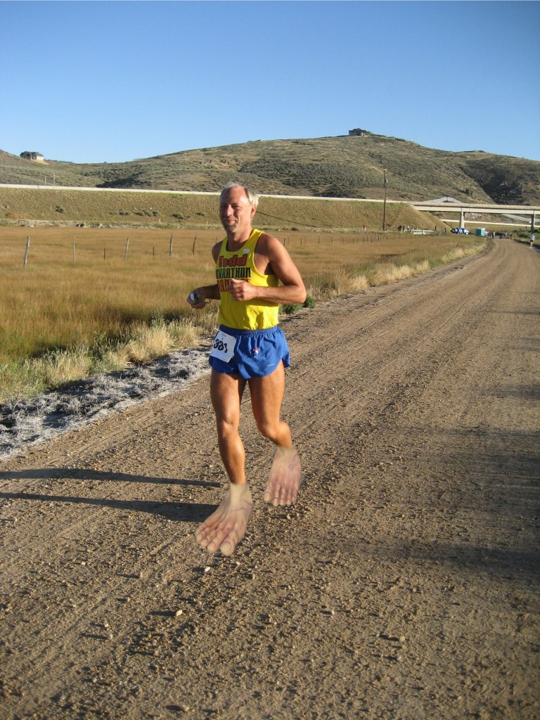 Todd with fake bare feet photo-edited over his shoes. 'Barefoot Shoes?' I don't understand why Todd didn't run this 8-mile section of gravel barefoot (2007-08-25) Park City Marathon UT.