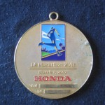 Ken's medal side A, LA Marathon 2002 March 3 Los Angeles CA