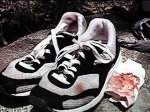 Ken Bob's bloody shoes after 18 miles (1998 May 10) Silverado Canyon, Orange CA - bloody napkin was from another runner who fell downhill on the gravel trails (possibly after tripping over a shoelace?)