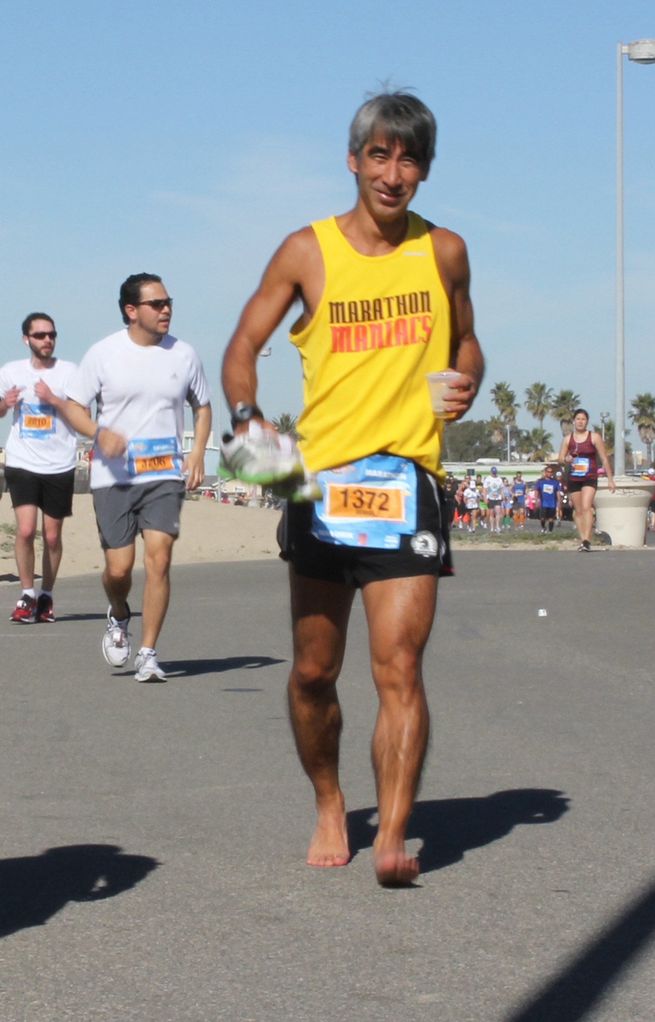 Dennis barefoot for camera (2012 February 5) Surf City Marathon
