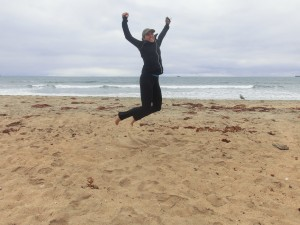 Eva jumping for joy at being in Huntington Beach California