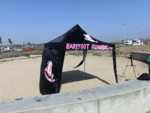 Look for a black canopy with BarefootRunning.com in hot pink letters