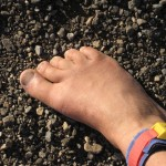 Ken Bob's bare foot on gravel