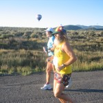 Ken Bob running, hot air balloon in background