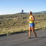 Todd running, hot air balloon in background