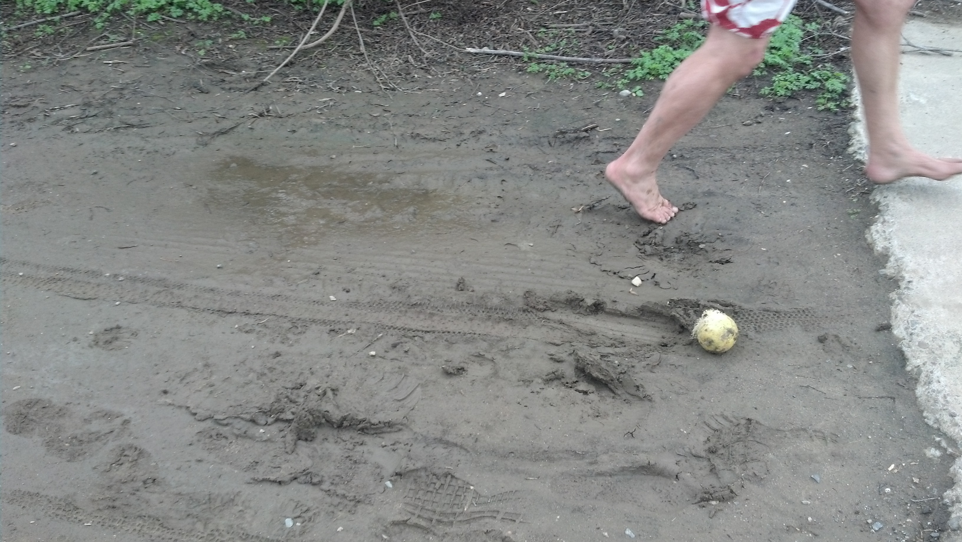 Ken Bob's foot in the mud (and a gourd)