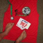 Shirt, medal, number (367), and feet