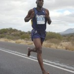 Bassirima Soro after removing his shoes at mile 14