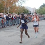 Bassirima Soro passes Peter Vail at the finish of Tucson Marathon in 2004 photo courtesy of David Bluestein