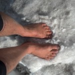 Ken Bob's feet cooling off in the snow, Vail Pass CO