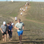 Practice the ups and downs of barefoot running on hills. 2009 December 19 Huntington Beach, California
