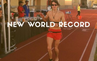 Man running barefoot on track, New World Record typed across photo
