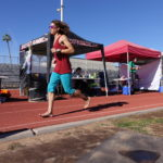 Barefoot Runner on track in front of BarefootRunning.com canopy